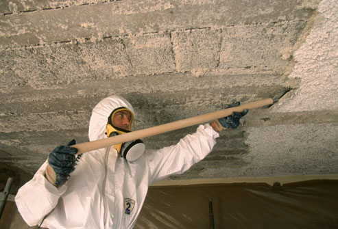 Asbestos insulation removal in an old building