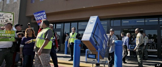 Walmart strikers, staff and shoppers at last year's Black Friday sale