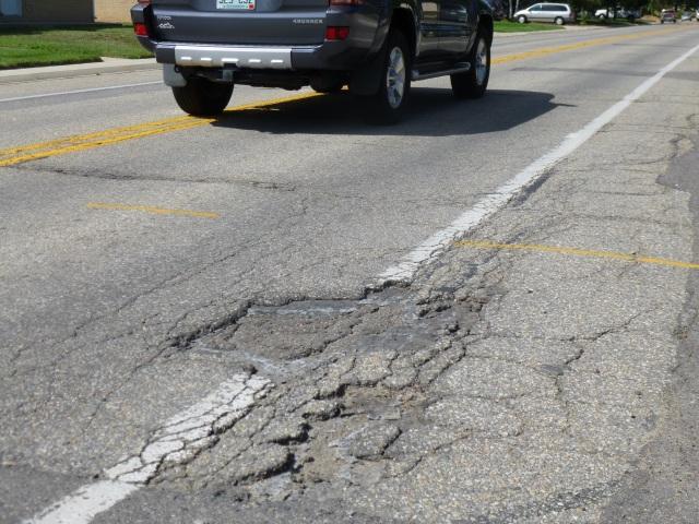 Driver Avoiding Pothole On Garrison St