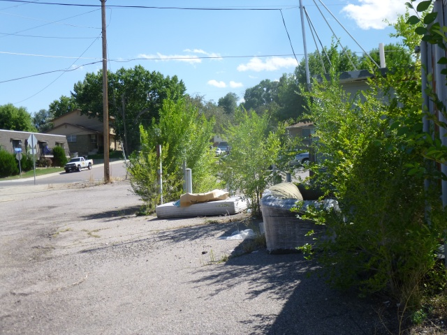 Trash and weeds on the old Diamond Shamrock site later cleaned up at the urging of AURA