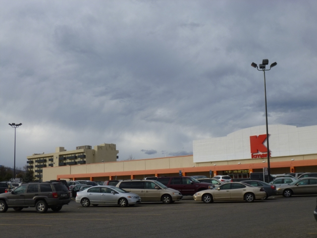 The Triangle's Kmart with the six-story Arvada House senior living apartments in the background