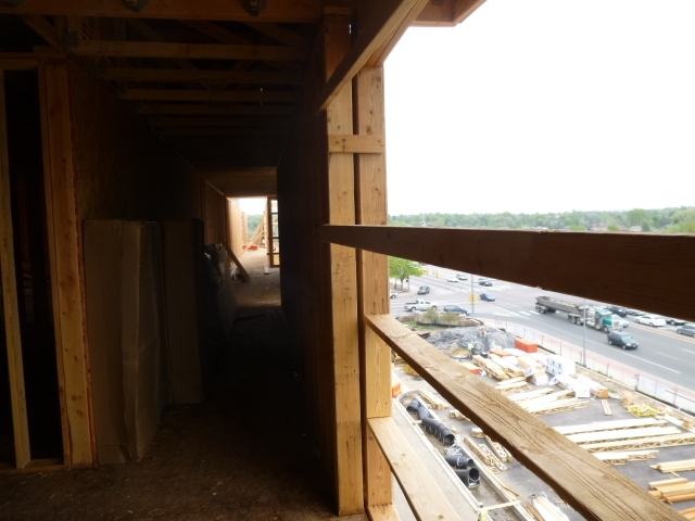 View to the north and the outdoor parking area -- only half the parking will be below the building